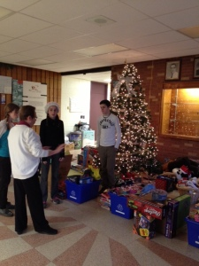 Students, parents and staff sorting and organizing our school Holiday Toy & Food drive donations.